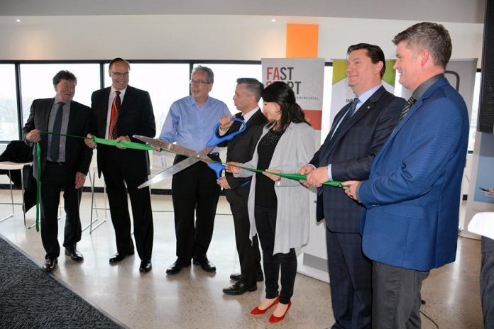 Cutting the ribbon at the newly renovated Innovation Cluster space at VentureNorth on April 19 (left to right): Fleming College president Dr. Tony Tilly, Peterborough Mayor Daryl Bennett, Peterborough M.P.P. Jeff Leal, Innovation Cluster Board Chair John Desbiens, Peterborough-Kawartha MP Maryam Monsef, Innovation Cluster President and CEO Michael Skinner, and Trent University Vice-President of Research and Innovation Dr. Neil Emery. (Photo: Eva Fisher / kawarthaNOW)