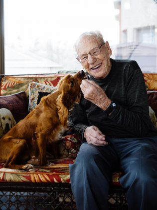 Former NHL goaltender Johnny Bower enjoying a moment with Jasper, a Cocker Spaniel rescue dog adopted by photographer Peter Nguyen, during a photo shoot for the Peterborough Humane Society's Shelter Shots 2018 calendar (photo: Peter Nguyen)