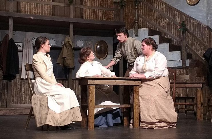 """Kate Suhr as Fiona Quinn, Mardi Kennedy as Moira Quinn, Max Czmielewski as Ronan O'Leary, and Kate Brioux as Maureen O'Leary in Paul Crough's original musical """"More Than A Memory"""", which runs from April 28 to May 13 at the Peterborough Theatre Guild. (Photo: Sam Tweedle / kawarthaNOW)"""