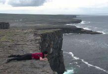 "In this scene from the award-winning ""Murphy's Law"", which returns to Showplace for a screening on May 12, filmmaker Megan Murphy lies at the edge of a cliff on the Aran Islands in Ireland. It was the same spot where her father, taking the same journey of self-discovery in 1973, decided to spend the rest of his life with Megan's mother. (Photo: Megan Murphy)"
