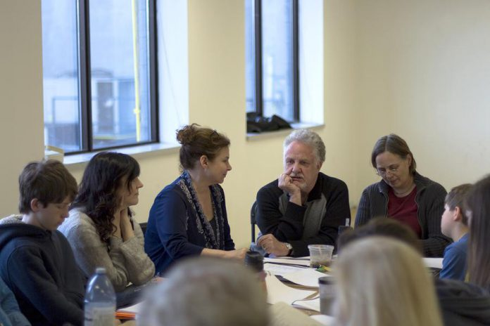 New Stages Theatre Company's production of Thornton Wilder's Our Town features a cast of 19 performers, some pictured here during a cast read-through: George Knechtel, Megan Murphy, director Linda Kash, Randy Read, stage manager Esther Vincent, and Logan Sword. The play runs April 28 to May 6 at the Market Hall in Peterborough. (Photo: Lindsay Unterlander / Adam Martignetti)