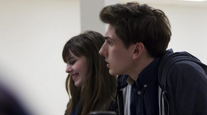 Bethany Heemskerk and Matthew Finlan, who perform in the leading roles of Emily Webb and George Gibbs, during a cast read-through of Our Town (photo: Lindsay Unterlander / Adam Martignetti)