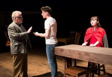 "Randy Read as The Stage Manager with Matthew Finlan as George Gibbs and Bethany Heemskerk as Emily Webb in New Stages' production of Thornton Wilder's ""Our Town"", on now until May 6 at the Market Hall in Peterborough. (Photo: Andy Carroll)"
