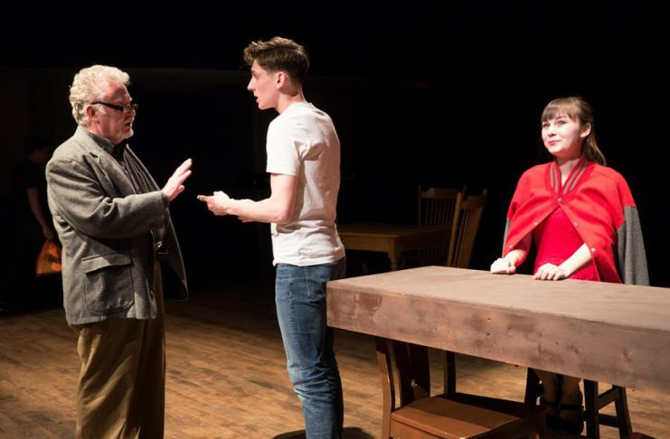 """Randy Read as The Stage Manager with Matthew Finlan as George Gibbs and Bethany Heemskerk as Emily Webb in New Stages' production of Thornton Wilder's """"Our Town"""", on now until May 6 at the Market Hall in Peterborough. (Photo: Andy Carroll)"""