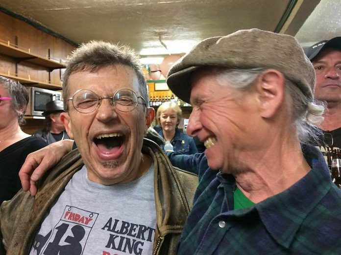 JP Hovercraft, whose band Rezonator hosted the final PMBA Deluxe Blues Jam and who also was celebrating his 65th birthday, enjoys a moment with fellow musician Bobby Watson (photo: Kate Kelly)