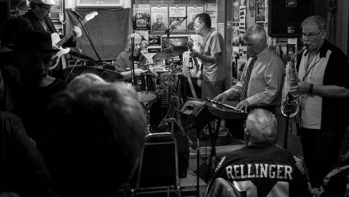 """They're just taking the dance to a new ballroom."" Paul Rellinger at the final Deluxe Blues Jam on April 15th. After the Pig's Ear closes for good on April 22nd, the monthly PMBA fundraiser will be held at Dr. J's BBQ and Brews. (Photo: SLAB Productions)"