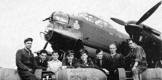 """4th Line Theatre's new play """"Bombers: Reaping the Whirlwind"""" by David S. Craig tells the story of a Canadian heavy bomber pilot serving with No. 6 Group RCAF of Bomber Command during the Second World War. Pictured are the aircrew and groundcrew of No. 428 Squadron (also known as the """"Ghost Squadron"""", one of the No. 6 Group RCAF squadrons) with their Avro Lancaster, which flew the squadron's 2000th sortie, a raid on Bremen in Germany. (Photo: Library and Archives Canada)"""