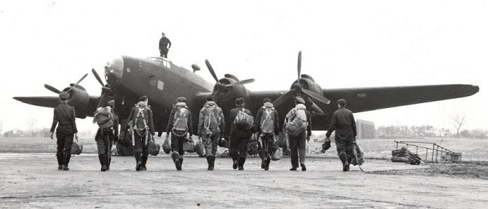 RCAF No. 6 Group aircrew walking to their Handley Page Halifax bomber in October 1944. (Photo: Department of National Defence PL-3394)