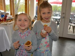 The Kawarthas Northumberland Butter Tart Tour is the biggest of its kind in Ontario, with over 50 participating bakeries. At an event at the Silver Bean Cafe launching the fifth year of the tour, Elle and Olivia sample the Goose Butter Tart from Ste. Anne's Spa and the Nanaimo Bar Butter Tart from the Magic Rolling Pin. (Photo: Eva Fisher / kawarthaNOW)