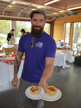 Geoff Kirkland of Firefly Bakery stuck to the Canadiana theme by using local products in their tarts tarts, including a tart made with Empire Cheese Curds in the crust. (Photo: Eva Fisher / kawarthaNOW)