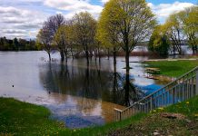 Little Lake rising above the retaining walls and flooding the parking lot at Ashburnham Lock 20 at Beavermead Park in Peterborough. Over 100mm of rain has already fallen in Peterborough since the beginning of May. (Photo: Bruce Head / kawarthaNOW)