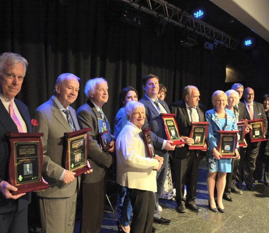 This year's honorees and their representatives: Peter Duffus, John Bowes, Elwood Jones, Mary McGee, Catia and Mike Skinner, Susan and Darrell Drain, Rhonda Barnet, Eleanor and Carl Young and Shelley and David Black. (Photo: Eva Fisher / kawarthaNOW.com)