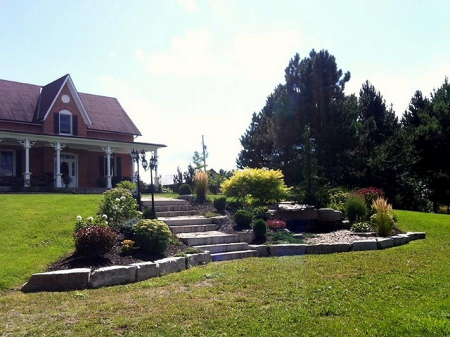 Low-maintenance landscaping means less work and more time enjoying your yard. (Photo: Kawartha Lakes Landscaping)