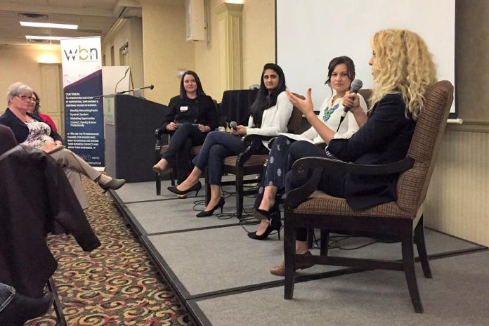 "Writer Jeanne Pengelly (left) listens during the ""Watch Out World"" panel discussion at the May 3rd meeting of the Women's Business Network of Peterborough (WBN) as Chimp Treats owner Brooke Hammer (right) speaks, alongside fellow panelists Jane Zima (second from right) and Sana Virgji with moderator and WBN director Paula Kehoe. (Photo: Rose Terry / Innovation Cluster)"