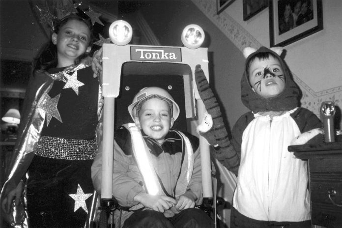 Siblings Rebecca, James, and Ben Birrell as children at Halloween. James was too ill to leave his wheelchair for trick or treating so a friend converted his wheelchair into this forklift costume.  (Photo: The Birrell family)