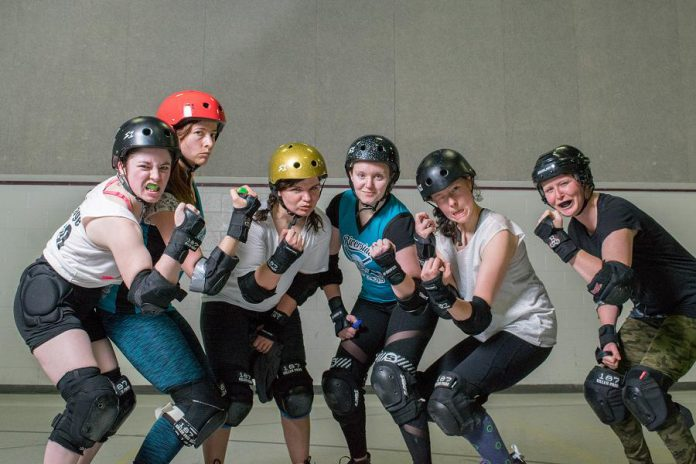 PARD members hamming it up for the camera at a recent practice. It's a full-contact sport, so skaters wear helmets, elbow pads, wrist guards, knee pads, and mouth guards.  (Photo: Scott Tromley)