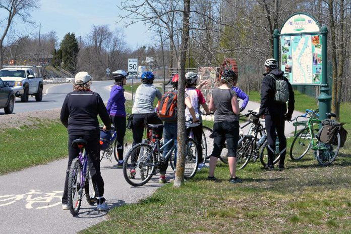 A group of cyclists gather at the Lakefield Trailhead just outside of Lakefield, after riding from Peterborough along the trail during a recent group tour. International Trails Day offers several opportunities to celebrate our local trails with guided or self-led events on foot or bicycle, on June 2nd and 3rd. (Photo: Jaime Akiyama)