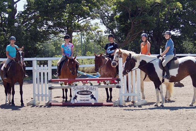 For the more experienced riders, athleticism is the focus, where campers improve their skills in advanced disciplines, like jumping and dressage. (Photo: Heather Leach / Seven Pines Stables)