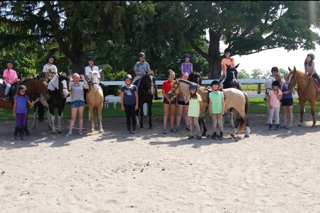 "At the end of the week, campers feature the skills and tasks they've learned from the program on what's called ""Show Off"" day for family and friends. (Photo: Heather Leach / Seven Pines Stables)"