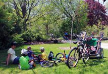 Family and friends enjoy a rest and a snack at GreenUP Ecology Park, along the Trans Canada Trail in East City, Peterborough. Summer is the perfect time to maximize outdoor time, which is essential for healthy childhood development and is beneficial for the physical and emotional health of all ages. (Photo: GreenUP)