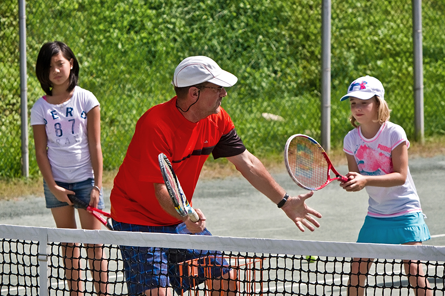 At Junior Tennis Camp, campers learn develop hand-eye coordination, basic stroke skills, and the fun of game play, all at the Quaker Park Tennis Club. (Photo: City of Peterborough Recreation Division)