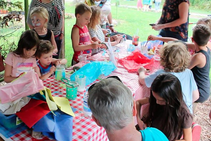 One way to make your kids' parties greener this summer is to nix the loot bags and involve your little partiers in a take-home craft instead. There will be less waste from individually packaged treats, less cost, and a lot more fun. Here children make take-home lanterns at last year's GreenUP Ecology Park Family Night. (Photo: GreenUP)