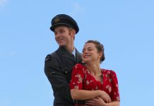 "Actors Michael Cox and Shaina Silver-Baird, who portray heavy bomber pilot Peter Benton and his love interest Emma in the upcoming 4th Line Theatre premiere production of David S. Craig's ""Bombers: Reaping the Whirlwind"", pose at a media event at Winslow Farm in Millbrook on June 21. (Photo: Caitlin McGill / 4th Line Theatre)"