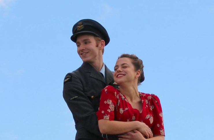 """Actors Michael Cox and Shaina Silver-Baird, who portray heavy bomber pilot Peter Benton and his love interest Emma in the upcoming 4th Line Theatre premiere production of David S. Craig's """"Bombers: Reaping the Whirlwind"""", pose at a media event at Winslow Farm in Millbrook on June 21. (Photo: Caitlin McGill / 4th Line Theatre)"""