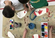 "Students from Peterborough's St. Paul and Immaculate Conception Catholic Elementary Schools working on ""Canada Walking Forward"", an art exhibit of 150 clay footprints of the students' own feet decorated to answer the question ""What does Canada mean to you?"". The exhibit is one of four student art exhibits that will be on display during Peterborough's four-day Canada 150 celebration from June 29 to July 2. (Photo: Canada 150th Committee)"