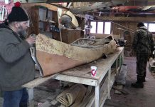 """Using traditional techniques, members of the Miawpukek First Nation from Newfoundland have built a 22-foot birch bark canoe they will present to The Canadian Canoe Museum on National Aboriginal Day (June 21). Described by the Mi'kmaq word """"gwitna'q"""", which means """"go by canoe"""", the canoe represents the reconciliation of aboriginals with the Canadian government on the 150th anniversary of Confederation. (Photo: Miawpukek First Nation)"""
