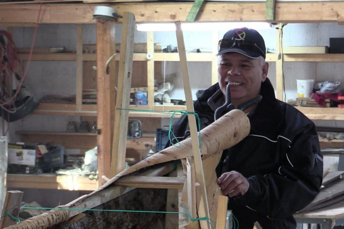 Chief Mi'sel Joe of the Miawpukek First Nation working on the canoe. (Photo: Miawpukek First Nation)