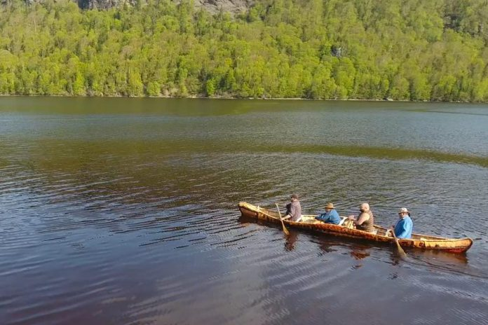 "Members of Miawpukek First Nation paddling the canoe, described with the Mi'kmaq word ""gwitna'q"", which means ""go by canoe"".  (Photo: Miawpukek First Nation)"
