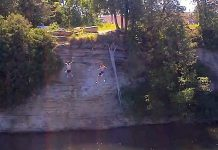 Two boys jumping off of a cliff in Fenelon Falls. 15-year-old boy Harley Broome of Fenelon Falls drowned Saturday afternoon after swimming with friends on the Sturgeon Lake side of the Fenelon Falls locks. (Photo: xorozzzi / YouTube)