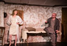 """In """"Frenzy for Two, or More"""", Kate Story and Dan Smith portray a couple who are trapped in their home and have a ridiculous argument about a tortoise and a snail while a war rages outside. (Photo: Andy Carroll)"""