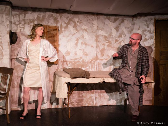 "In ""Frenzy for Two, or More"", Kate Story and Dan Smith portray a couple who are trapped in their home and have a ridiculous argument about a tortoise and a snail while a war rages outside. (Photo: Andy Carroll)"