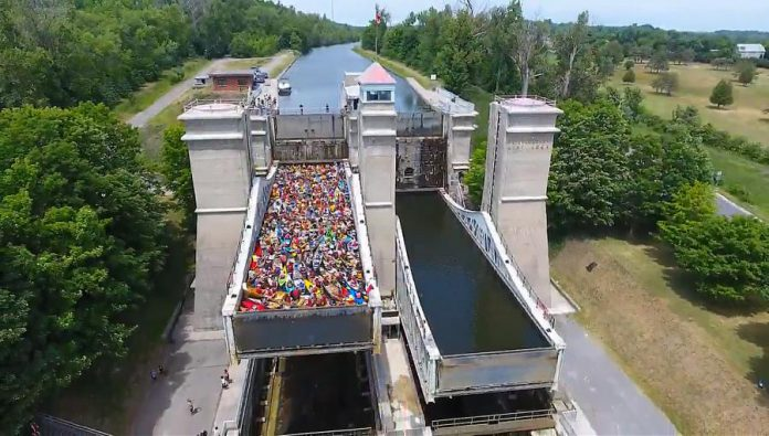 A screenshot from the 2016 drone video showing the 138 canoes and kayaks being lifted in one chamber of the Peterborough Lift Lock. This year, both lock chambers will be filled with 150 paddlecraft for a total of 300.