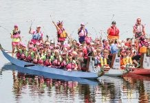 Paddlers at the 2015 Peterborough's Dragon Boat Festival hold their flowers prior to the Carnation Ceremony, an annual tradition to both remember and honour those who have lost their battle with breast cancer. The Carnation Ceremony originates from a 1996 dragon boat race in Vancouver.