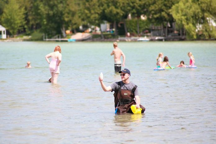 An inspector with Peterborough Public Health sampling water quality at a local beach. (Photo: Peterborough Public Health)