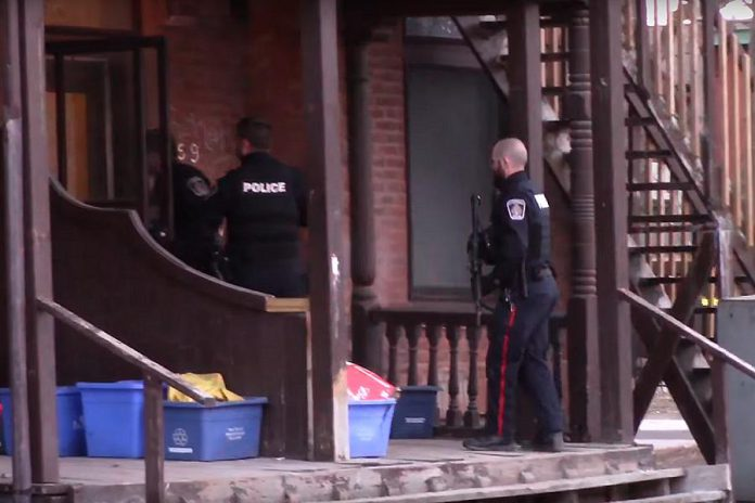Peterborough police at a Water Street rooming house in March 2017, following an incident where a man was shot multiple times. (Photo: Peterborough Scanner Feed / YouTube)