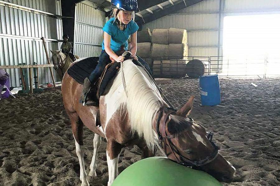 Campers spend all day doing a variety of riding and ground activities, such as roping, jumping, bareback riding, games, trust-building exercises, and more. (Photo: Partridge Horse Hill)