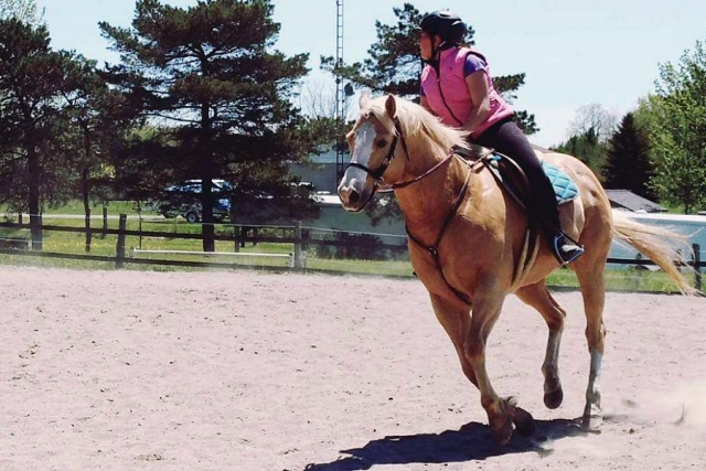 Learning to ride a horse can be empowering for children and also helps build their confidence, leadership and communication skills, and body language. (Photo: Partridge Horse Hill)