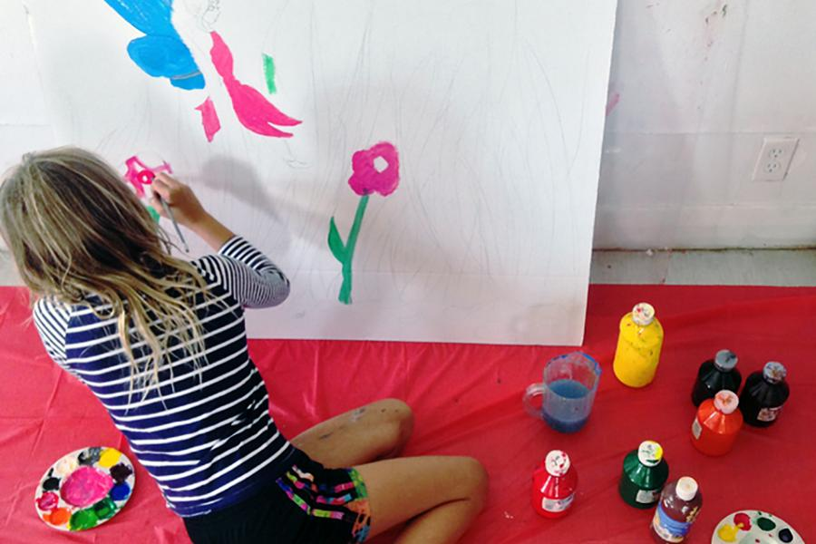A young artist makes art in the studio. The Art Gallery of Peterborough offers many opportunities for campers to have fun drawing, painting, and printing while at camp. (Photo: Art Gallery of Peterborough)