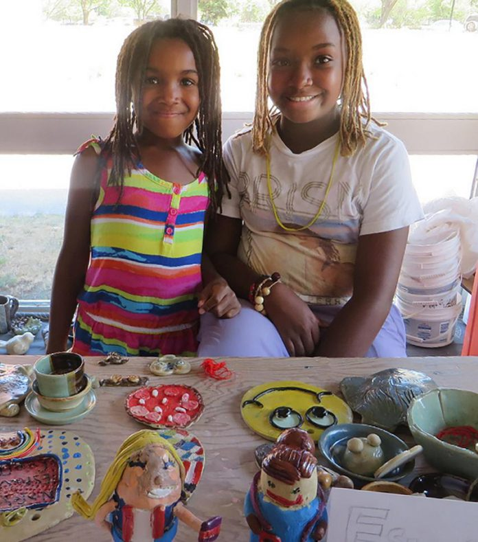 Two young artisans pose with their clay creations. Ceramic arts is proving to be a very focused, relaxing and meditative kind of craft. Subconsciously, children are directing their focus and energy towards building something. (Photo:  Kawartha Potters' Guild)