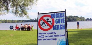 Visitors to Rogers Cove in Peterborough enjoy the waterfront, despite the beach being posted as unsafe. When bacteria counts exceed 100 E. coli per 100mL of water, the beach is considered unsafe for swimming. Primary inputs of E. coli in Peterborough area beaches are due to the presence of waterfowl faeces. (Photo: GreenUP)