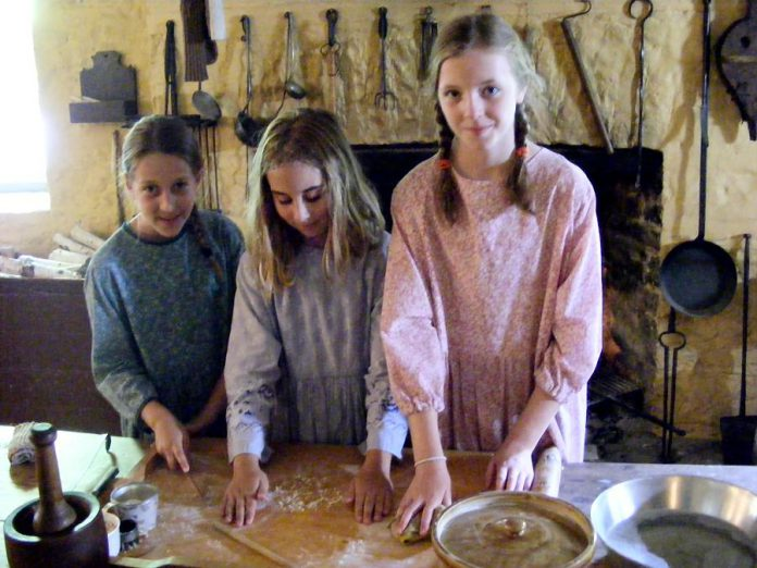 Volunteers play an important role at Hutchison House. Some wear period costumes and assist with public tours and special events. (Photo: Hutchison House Living Museum)