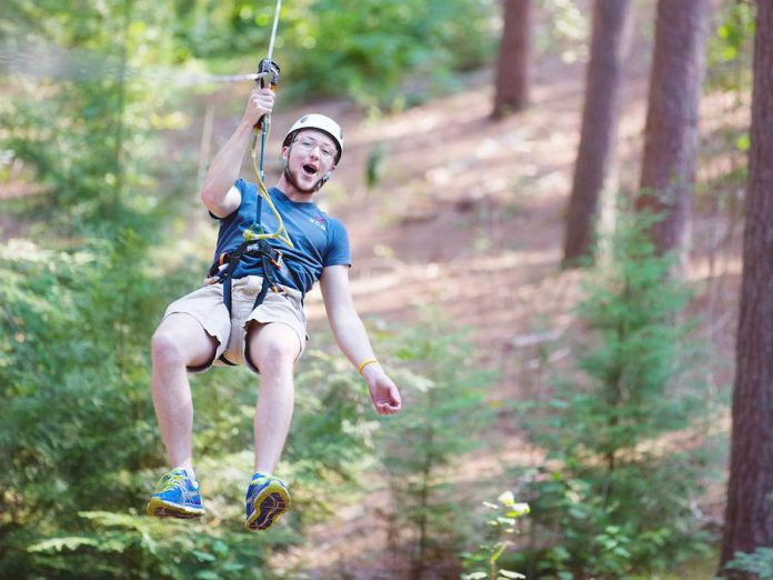 You can trek from tree to tree on fun games like suspended bridges, Tarzan swings, swinging logs, cable traverses, and of course, zip lines.  (Photo: Treetop Trekking Ganaraska)