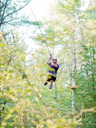 One of the advanced courses, the Flying Falcon, consists of four ziplines and three suspended bridge obstacles crisscrossing the forest. This zipline is the longest at 450 feet long and it takes about 10 seconds to cross the distance.   (Photo: Treetop Trekking Ganaraska)