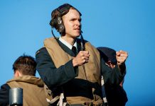 "Michael Cox in the lead role as young World War II bomber pilot Sgt. Peter Benton in 4th Line Theatre's wonderful historical drama ""Bombers: Reaping the Whirlwind"", playing now until July 29th at the Winslow Farm in Millbrook. (Photo: Rebekah Littlejohn)"