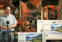 David Feeley, Senior Manager at Cogeco Connexion, which has donated 14 new televisions to The Canadian Canoe Museum. (Photo: The Canadian Canoe Museum)