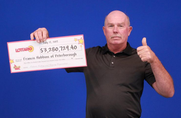 Francis Hobbins of Peterborough with his cheque for $3,280,729.40. (Photo: Ontario Lottery and Gaming)